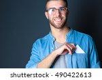 man holding a credit card | Shutterstock . vector #490422613