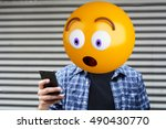 surprise emoji head man using a ... | Shutterstock . vector #490430770