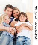 united family watching... | Shutterstock . vector #49043407