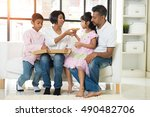 happy indian family eating... | Shutterstock . vector #490482706