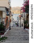 Small photo of Architecture of Sita town with old houses and stone road on Crete island, Greece