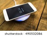 white smartphone charging on a...   Shutterstock . vector #490532086