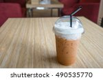 a cup of thai ice tea is on the ... | Shutterstock . vector #490535770