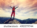 cheering young woman hiker open ... | Shutterstock . vector #490579744
