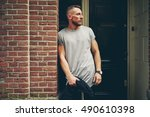 young bearded hipster wearing a ... | Shutterstock . vector #490610398