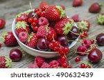 ripe berries on the wooden...   Shutterstock . vector #490632439