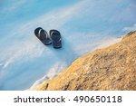 pair of flip flops on the beach ... | Shutterstock . vector #490650118