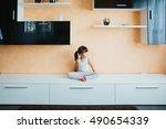 child doing yoga on the... | Shutterstock . vector #490654339