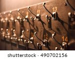hangers with numbers in a dark... | Shutterstock . vector #490702156