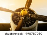 Small photo of Airplane propeller in the sunset. Plane engine. Aircraft.