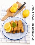 Small photo of deep fried fish finger made from alaska pollock fish with slice lemon and parsley on a plate