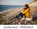 Young Woman Drinking Tea From...