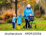 happy senior lady with a walker ... | Shutterstock . vector #490910356