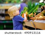cute toddler boy in a food... | Shutterstock . vector #490913116