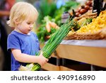 cute toddler boy in a food... | Shutterstock . vector #490916890