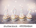 2017 happy new year cupcakes... | Shutterstock . vector #490984864