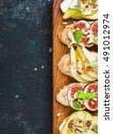 crostini with pear  ricotta... | Shutterstock . vector #491012974