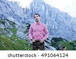 a traditional bavarian man on... | Shutterstock . vector #491064124