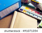 desk of an artist with lots of... | Shutterstock . vector #491071354