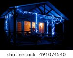 christmas lights. small wooden... | Shutterstock . vector #491074540