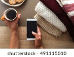 Hands Holding Coffee And Phone...