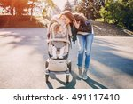 young mother walking with her... | Shutterstock . vector #491117410