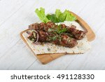 lamb kebab with onion and... | Shutterstock . vector #491128330