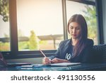 businesswoman working at office   Shutterstock . vector #491130556