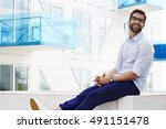 happy man smiling in blue... | Shutterstock . vector #491151478