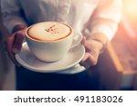 cappuccino with barista hands | Shutterstock . vector #491183026