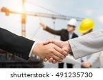 engineer holding yellow helmet...   Shutterstock . vector #491235730
