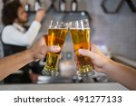 two men toasting a glass of... | Shutterstock . vector #491277133