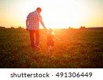 dad and daughter walking in...   Shutterstock . vector #491306449