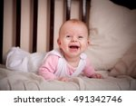 happy baby lying on the bed | Shutterstock . vector #491342746
