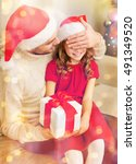 Small photo of family, christmas, x-mas, winter, happiness and people concept - smiling father surprise daughter with gift box covering eyes with hand