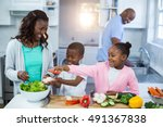 happy family preparing food in... | Shutterstock . vector #491367838