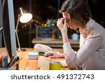 stressed businesswoman sitting... | Shutterstock . vector #491372743