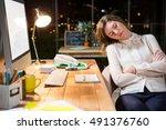 tired businesswoman sleeping on ... | Shutterstock . vector #491376760