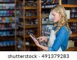 smiling female staff using... | Shutterstock . vector #491379283
