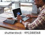 man doing online shopping with... | Shutterstock . vector #491388568