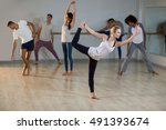 woman performing stretching... | Shutterstock . vector #491393674