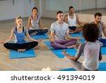 instructor taking yoga class in ...   Shutterstock . vector #491394019