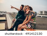 man and women sitting on roof... | Shutterstock . vector #491412130