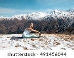 woman is practicing yoga... | Shutterstock . vector #491456044