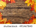 autumn leaves on the wooden... | Shutterstock . vector #491467840