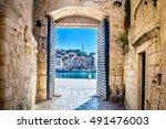 View at city gate in old mediterranean town Trogir, Croatia Europe. / City gate Trogir. / Selective focus.