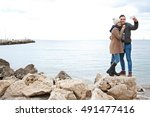 young tourist couple taking... | Shutterstock . vector #491477416