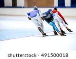 three athletes skating on ice... | Shutterstock . vector #491500018