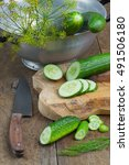 Small photo of Various types of cucumber, rustic ambiance