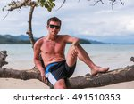 a guy sitting in a tree on the... | Shutterstock . vector #491510353